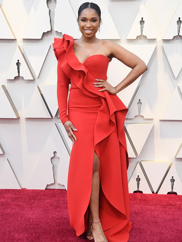 Singer and actress Jennifer Hudson bravely clashes with the red carpet in a coral one-shoulder dress by Elie Saab.
