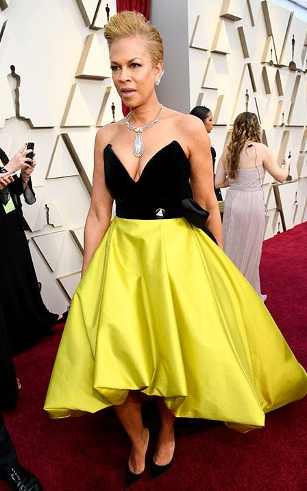 Tonya Lewis Lee's satin yellow mullet skirt and velvet bodice won't be landing her on any best dressed list but we appreciate the producer bringing a touch of the eighties to the red carpet. *(Image: Getty)*