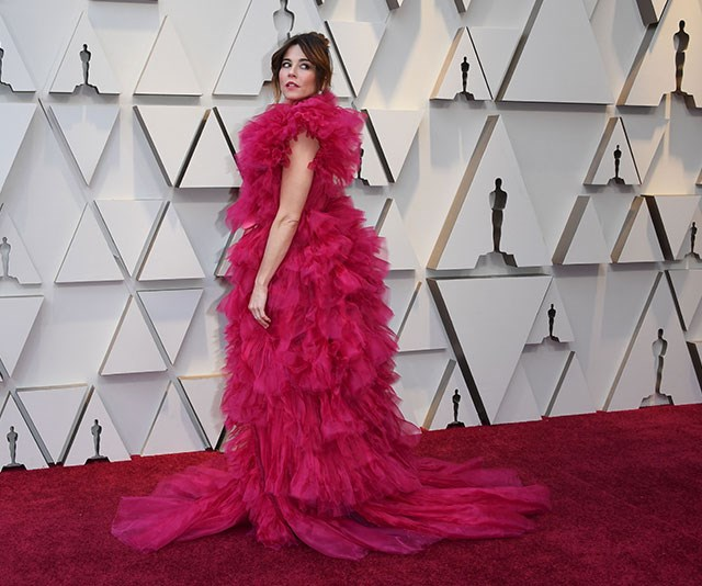 Peek-a-boo! If you squint hard enough, you'll see actress Linda Cardellini hiding behind all that pink tulle. *(Image: Getty)*