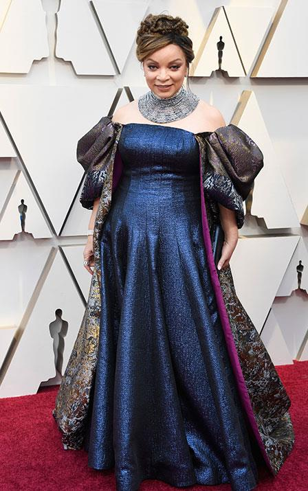 Best Costume Design nominee Ruth E. Carter wants you to know she is far from a shrinking violet in this metallic gown. *(Image: Getty)*