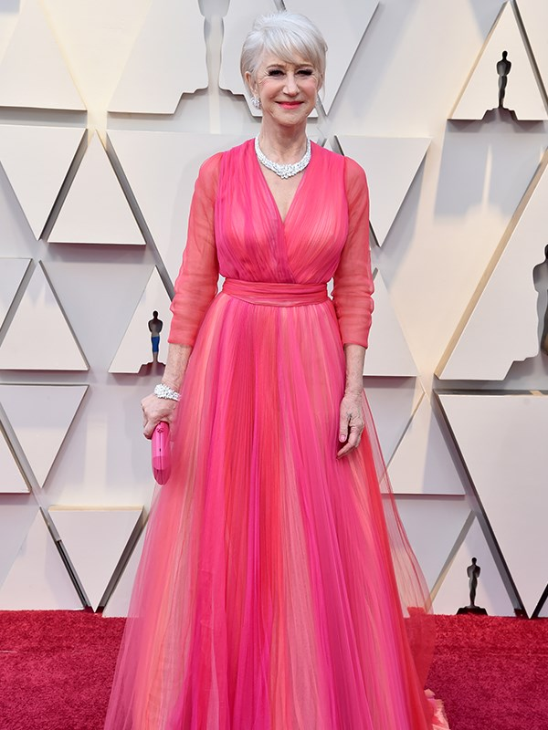 Pretty in pink! British actress and Hollywood stalwart Helen Mirren is an absolute vision in a fuchsia gown by Schiaparelli Haute Couture.