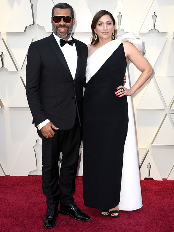 Another day, another Hollywood golden couple take the red carpet - this time, Jordan Peele and Chelsea Peretti are all kinds of powerful in their monochrome ensembles.
