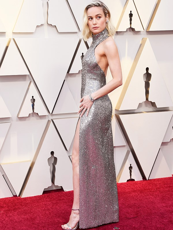 *Captain Marvel* actress Brie Larson take modernity to a new level in this figure-hugging, slinky metallic dress.
