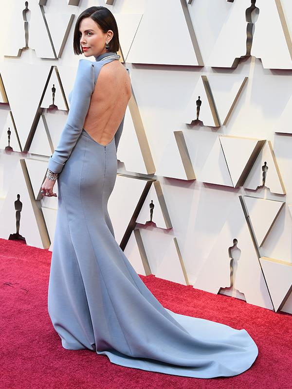 "New man, new do! Debuting a [brand-new hair colour](https://www.nowtolove.com.au/beauty/makeup/oscars-2019-red-carpet-beauty-looks-54262|target=""_blank""), Charlize Theron is oozing class in her powder blue Dior Couture gown."