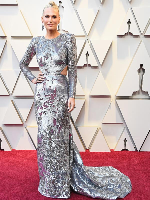 American actress Molly Sims takes a futuristic route in a sequined Zuhair Murad Couture dress.
