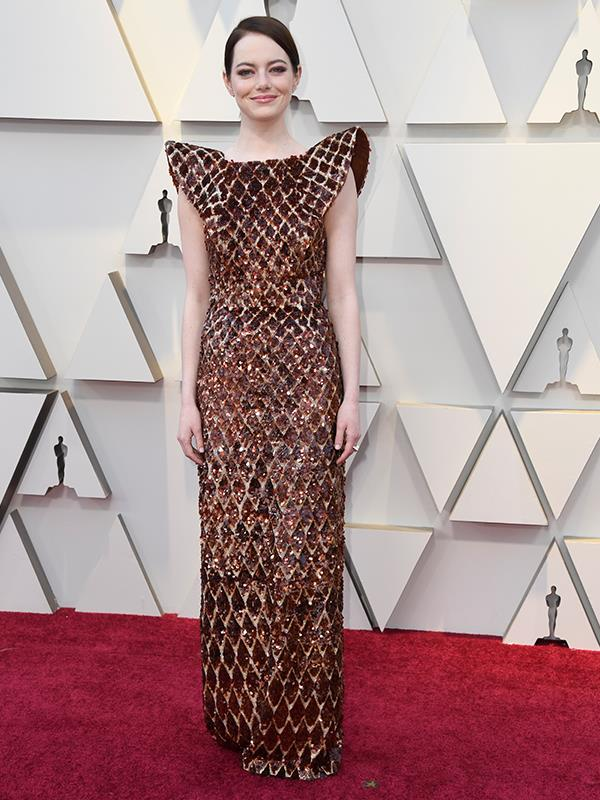 There's *a lot* to take in here - Emma Stone's Louis Vuitton gown has all the ingredients of success with a bold shoulder and fitted silhouette, but is it a knockout? We're not so sure...