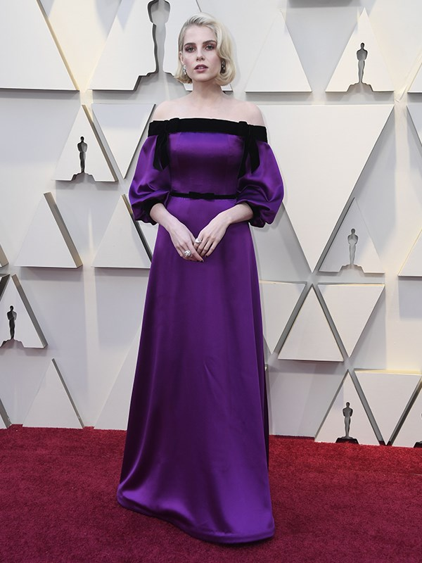 25-year-old American-British actress Lucy Boynton stole our hearts in *Bohemian Rhapsody*, but her Oscar red carpet performance isn't *quite* so showstopping in her custom Saint Laurent ensemble.