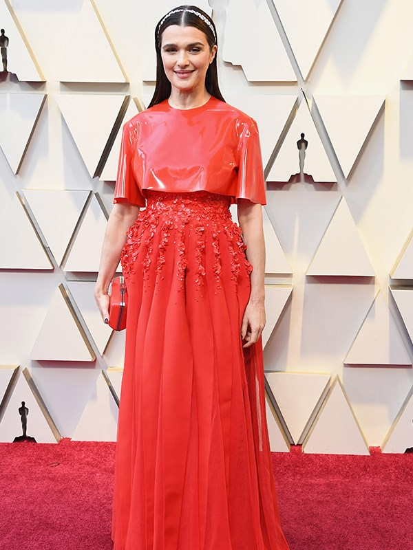 """Rachel Weisz is giving us MAJOR Meghan Markle vibes in her bright red Givenchy ensemble. The Duchess of Sussex wore a [*very* similar style](https://www.nowtolove.com.au/royals/british-royal-family/meghan-markle-prince-harry-morocco-54297