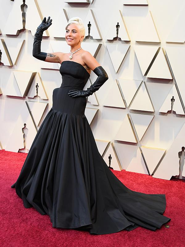 The star has arrived! Best Actress nominee Lady Gaga's colour choice might be ordinary, but this Alexander McQueen style is anything but - in fact, this might be the first time we've seen hip buttresses and leather gloves in one look. Gaga finished off her elegant ensemble with the ultimate piece of bling - a one-of-a-kind Tiffany Diamond necklace valued at over $30 million and last worn by the iconic Audrey Hepburn in 1961.