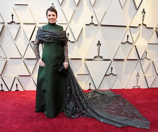 *The Favorite* actress Olivia Colman goes all out in a moss green Prada gown embellished with a grey shawl - fit for a Queen!