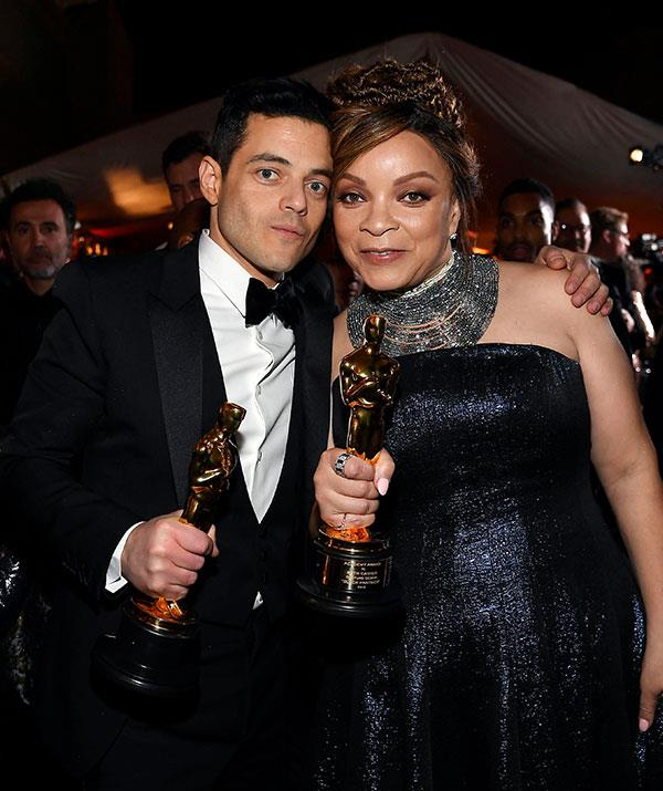 It's a gold statue-off between Rami Malek and costume designer Ruth E. Carter. *(Image: Getty)*