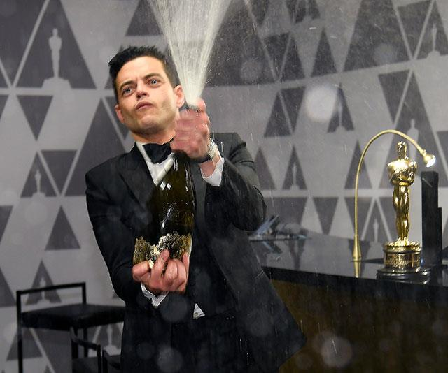 "It's champagne showers for [Best Actor winner Rami Malek](https://www.nowtolove.com.au/celebrity/celeb-news/oscar-winners-2019-54250|target=""_blank"") - and rightly so! *(Image: Getty)*"