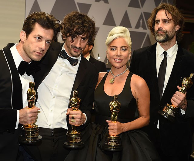 Four gold statues and four happy winners. *(Image: Getty)*