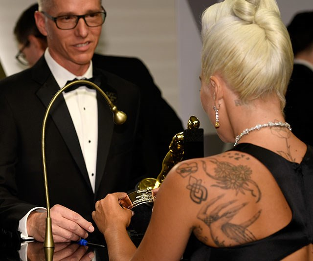 Gaga gets her name engraved on her gong *(Image: Getty)*