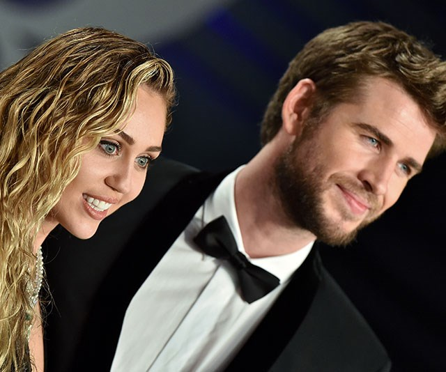 Newlyweds Miley Cyrus and Liam Hemsworth couldn't have looked more loved up as they arrived to the Vanity Fair Oscar Party at the Wallis Annenberg Center for the Performing Arts on in Beverly Hills. *(Image: Getty)*