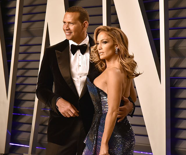 But her best accessory? Her dashing plus one, Alex Rodriguez. *(Image: Getty)*