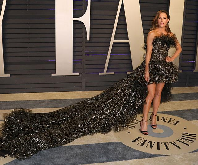 Kate Beckinsale proves a long train and a short hemline can totally work. *(Image: Getty)*