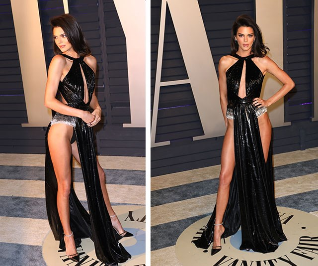 WOAH! Kendall Jenner turned heads in this thigh-high dress that gave the optical illusion that she was pretty much naked. *(Image: Getty)*