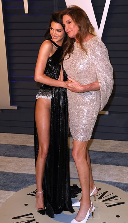 Keeping up with the Jenners! Kendall cuddles up to proud parent, Caitlyn Jenner. *(Image: Getty)*