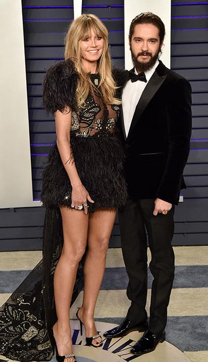 Heidi Klum cuddles up to fiance Tom Kaulitz. *(Image: Getty)*