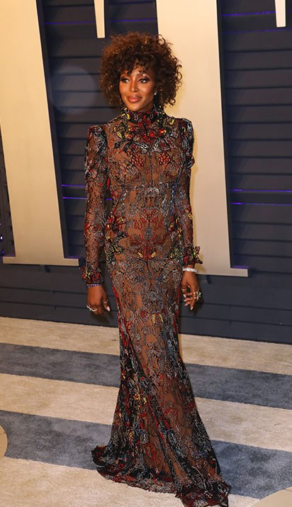 Naomi Campbell opted for a sheer Alexander McQueen dress. *(Image: Getty)*