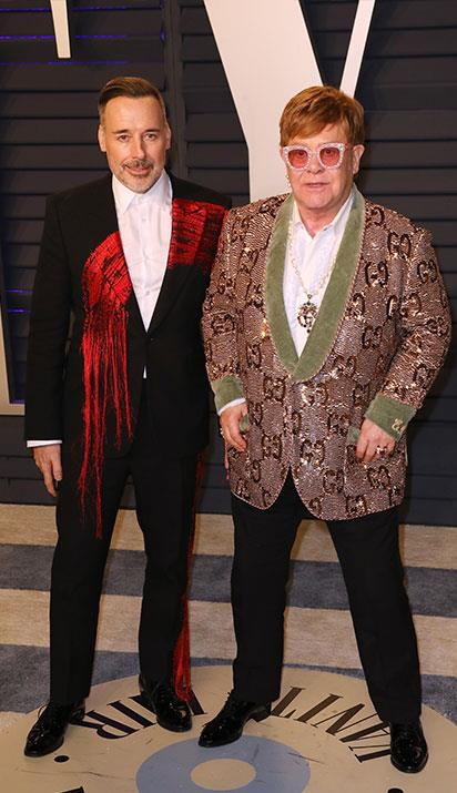 David Furnish and Elton John attend the 2019 Vanity Fair Oscar Party. *(Image: Getty)*