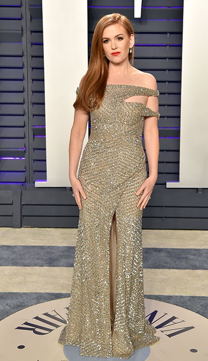 Homegrown hero and superstar Isla Fisher channelled old Hollywood glamour in this metallic gold, off-the-shoulder number for the *Vanity Fair* bash. *(Image: Getty)*
