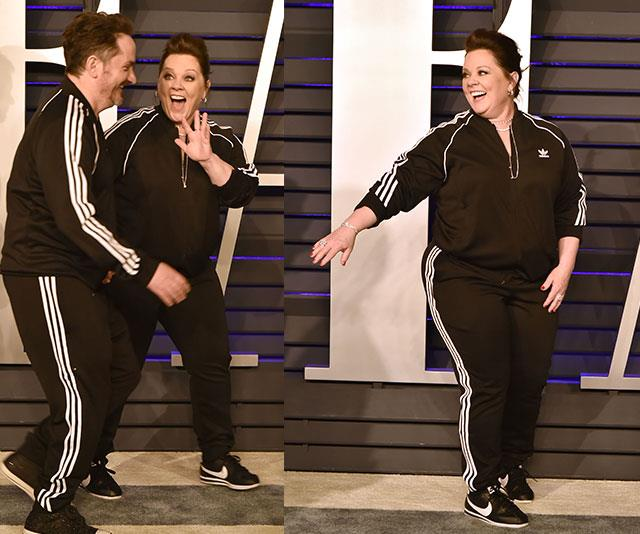 We are not worthy of Melissa McCarthy and her husband Ben Falcone rocking up to the swanky VF after party in matching tracksuits. *(Image: Getty)*