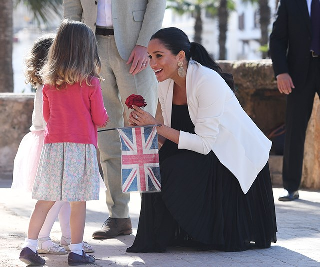 The two young girls presented the royals with flowers. *(Image: Getty)*
