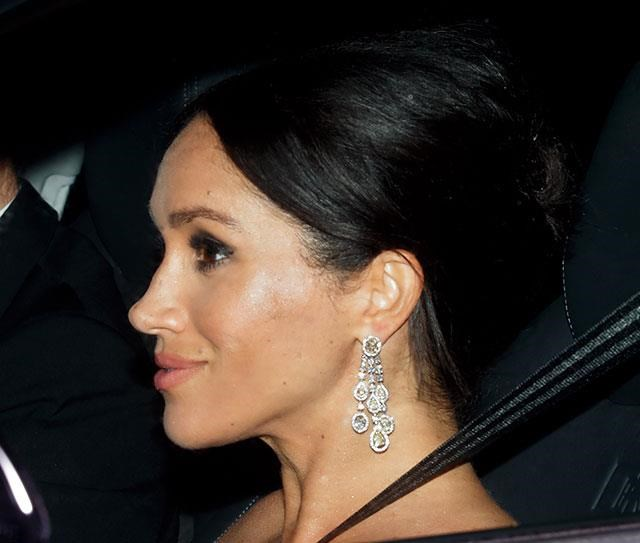 And arriving by separate car was none other than Meghan Markle, looking stunning in dripping diamond earrings. *(Image: Getty)*