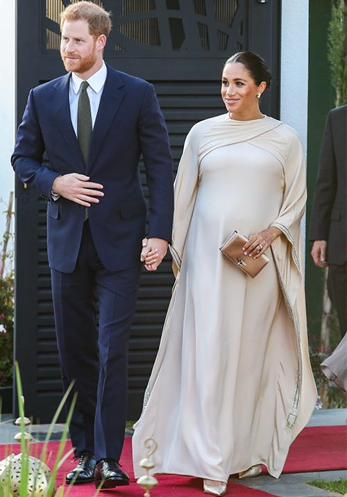 Heavily pregnant Meghan stepped out in a stunning Dior gown while in Morocco in February.  *(Image: Getty)*