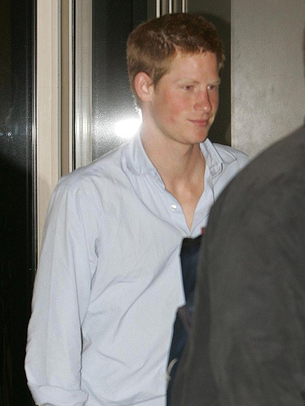 Young Harry got into a scuffle with a photographer outside a London nightclub in 2004. *(Image: Getty)*