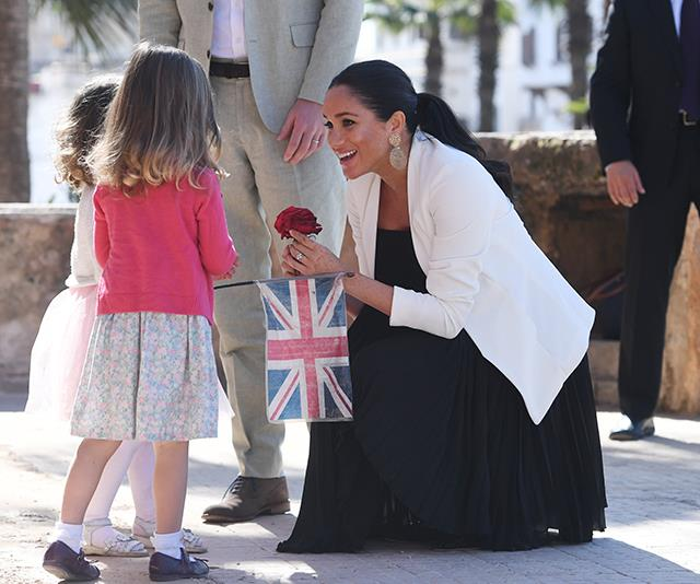 Meghan hasn't held back from embracing the royal tour in Morocco, despite being heavily pregnant. *(Image: Getty)*