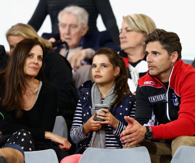 Eric Bana, daughter Sophia and wife Rebecca Bana take in an AFL match in 2013. *Image: Getty.*