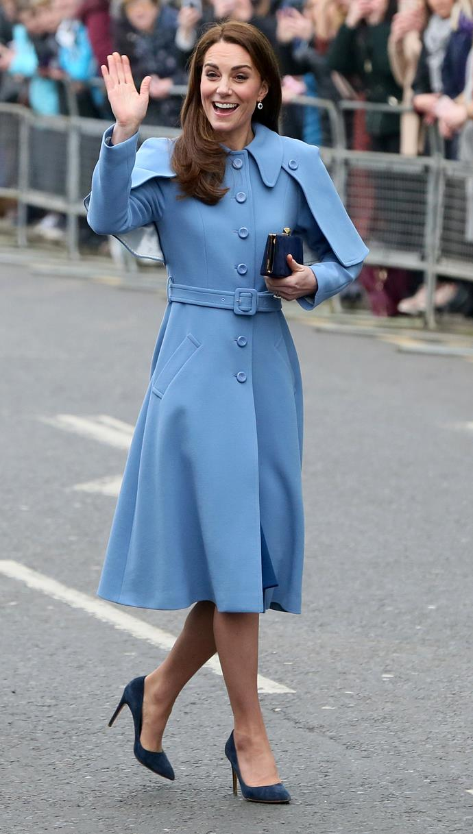 Duchess Catherine waves to the crowds in a stunning Mulbery coat that costs over $3000. *(Image: Getty)*