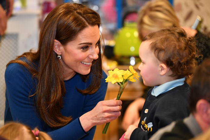Kate plays with a cute kid in Ireland. *(Image: Getty)*