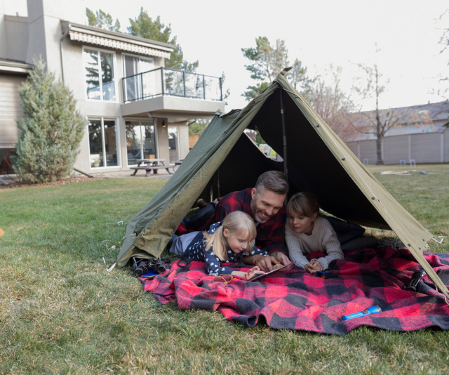 **Backyard camping:** You don't need to travel far to have an adventure. Setting up camp and spending the night in your own backyard will introduce you to a whole new world, just outside the back door! *Image: Getty.*