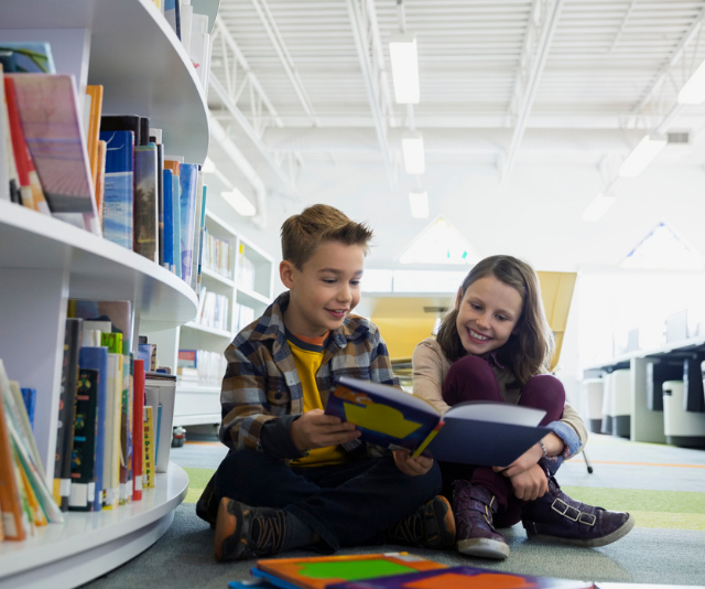 **Visit your local library:** Exploring your local library is a perfect all-weather activity, and best of all, it's free. Load up on books to read together and you've covered off more than one day's worth of entertainment in one hit! *Image: Getty.*