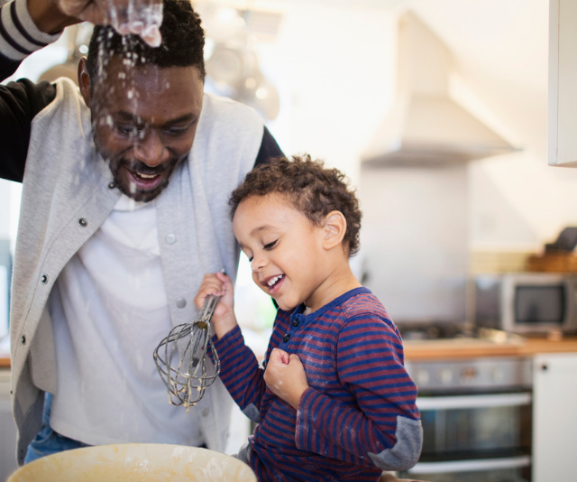 **Cooking in the kitchen:** Get ready to make a little mess! Set up some batch baking activities and cook the day away making snacks and treats to get you through the rest of the holidays. *Image: Getty.*