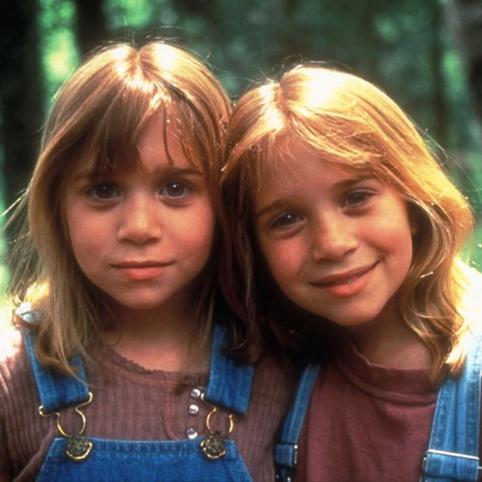 **It Takes Two** An orphan girl and a wealthy girl (played by Mary-Kate and Ashley Olsen) - who happen to look identical - switch places to stitch up the adults in their life. *Image: Warner Bros.*