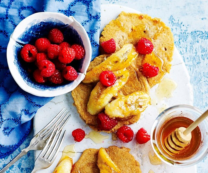 """**Gluten-free pancakes with grilled honey bananas and raspberries** <br><br> Pancakes are one of the best parts of weekends, apart from sleep-ins, of course. But you don't need to miss out because you've cut out gluten from your diet. This recipe is delicious AND tummy-friendly. <br><br> See the full *Australian Women's Weekly* recipe [here](https://www.womensweeklyfood.com.au/recipes/gluten-free-pancakes-with-grilled-honey-bananas-and-raspberries-1600