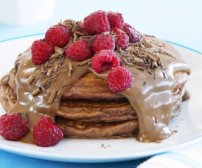 """**Chocolate pancakes with chocolate custard** <br><br> Our fluffy buttermilk chocolate pancakes are for true chocolate-lovers only! Topped with a homemade thick and creamy chocolate custard and fresh raspberries, it's the ultimate chocoholics' dessert. <br><br> See the full *Australian Women's Weekly* recipe [here](https://www.womensweeklyfood.com.au/recipes/chocolate-pancakes-with-chocolate-custard-7827