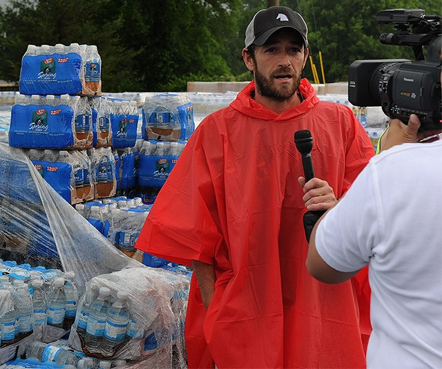 Putting his celebrity status towards the greater good, Luke proved his passion for social change by volunteering with charity Soles4Souls where he helped flood victims in Nashville. *(Image: Getty)*