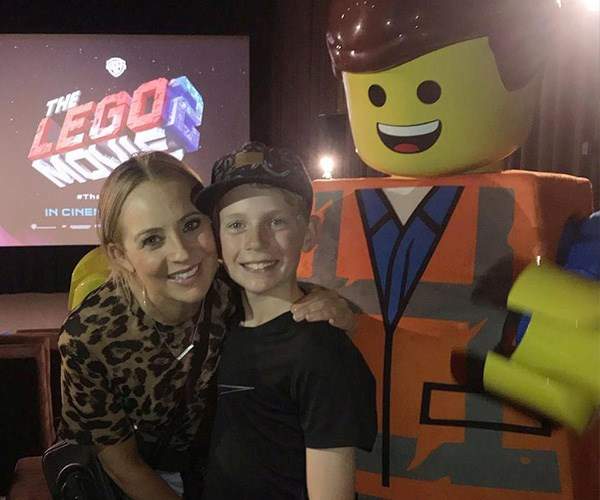 """""""One of the little perks of not working nights at the moment is getting to see a movie with Ollie and his mates at 6pm on a Thursday night."""" Carrie recently enjoyed some mum and son time with oldest child Ollie at *The Lego Movie*. *(Image: Instagram @bickmorecarrie)*"""