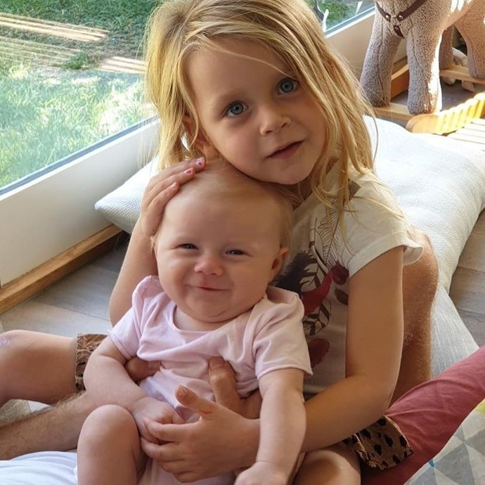 Our ovaries are exploding! Evie is the perfect big sister. *(Image: Instagram @walkschris21)*