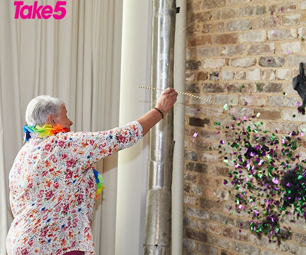 Suzanne thrust her pin into the balloon and purple and green confetti floated to the floor.