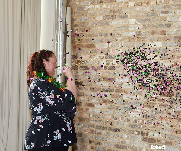The crowd held their breath as Megan popped the second balloon to reveal purple and green confetti.