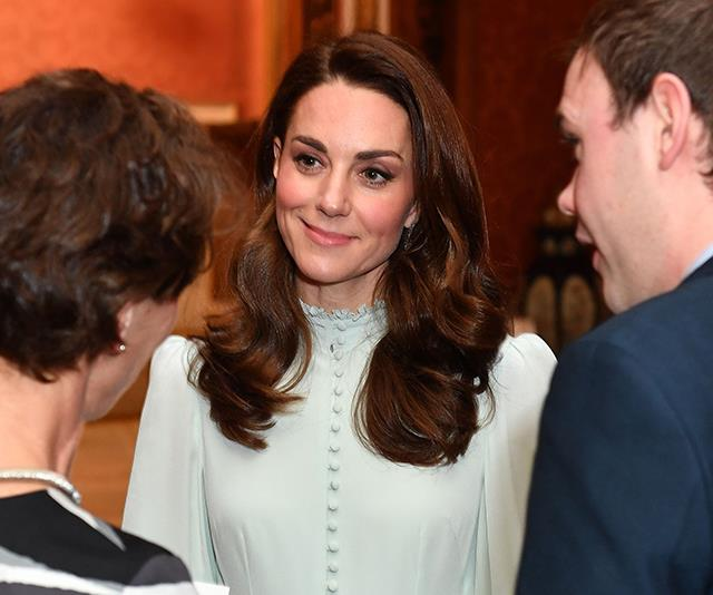 The mum-of-three opted for her signature brown waves to finish the look. *(Image: Getty)*