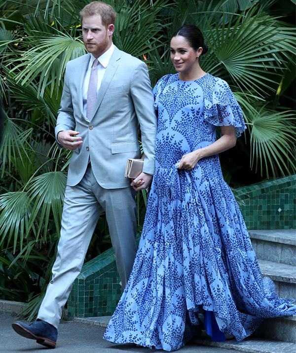 "After a full day of activities during her royal tour of Morocco, Duchess Meghan [attended an evening soiree](https://www.nowtolove.com.au/royals/british-royal-family/meghan-markle-morocco-outfit-fashion-54315|target=""_blank"") with Prince Harry wearing a gorgeous blue Carolina Herrera gown. *(Image: Getty Images)*"