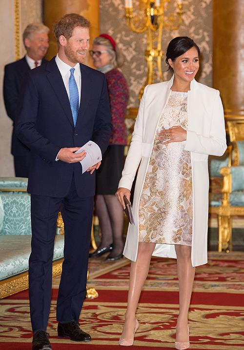 "With her due date fast approaching, Meghan stepped out in a brocade knee-length dress (the designer of which is yet to be identified) during a [celebration of Prince Charles' investiture](https://www.nowtolove.com.au/royals/british-royal-family/meghan-markle-kate-middleton-investiture-54479|target=""_blank"") at Buckingham Palace in early March. *(Image: Getty Images)*"